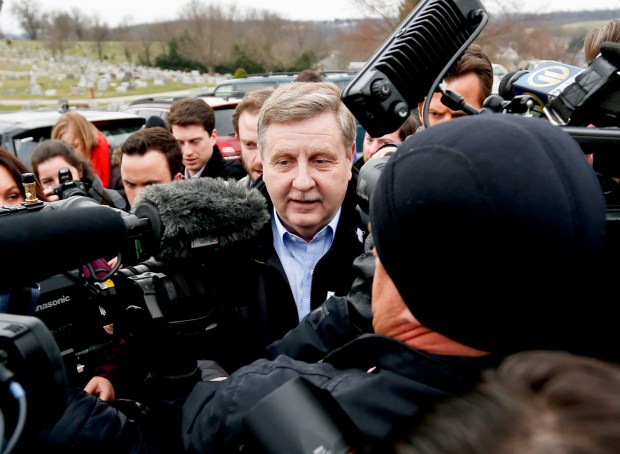 Republican Rick Saccone, center, is surrounded ...
