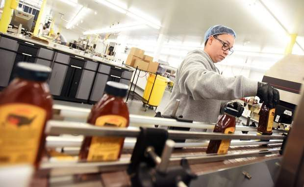 Rebecca Valdez works on the assembly line at Rice's Honey last week at the Rice's Honey facility, 3331 W 29th St. in Greeley.
