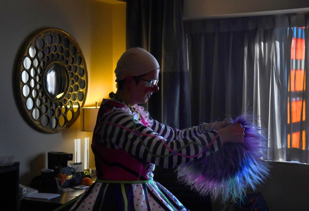 "Former Ringling Bros. clown Tricia ""Pricilla Mooseburger"" Manuel gets ready to don her wig before her World Clown Convention performance."