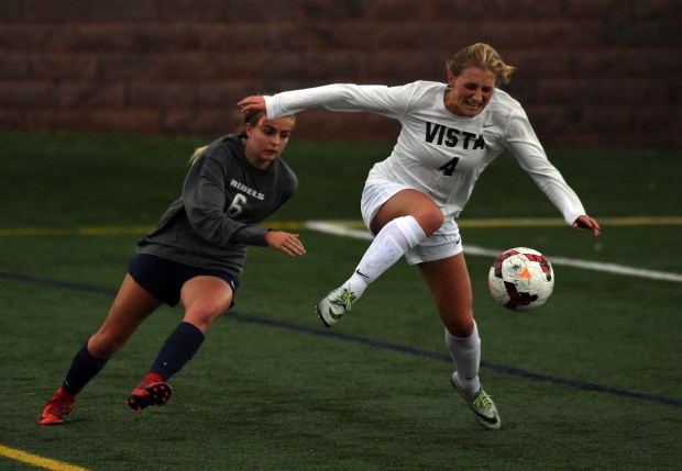 Mountain Vista Savannah Mills (4) kicks the ball away form Columbine Chloe Cook (6) during their soccer game on March 15, 2018 at Shea Stadium in Highlands Ranch, Colorado. CHSAA lost over 70 players to the U.S. Girls Development Academy this year, mostly from schools in the south metro area.