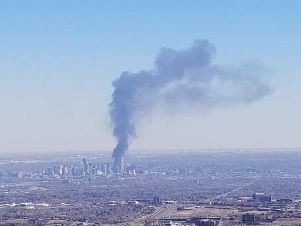 A plume of smoke from the massive Wednesday afternoon fire at a construction site in Denver's North Capitol Hill neighborhood is seen from Apex Park in Golden.