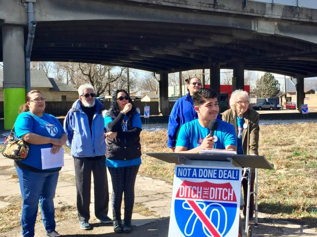 "Rueben Sanchez speaks about health problems in neighborhoods near the Interstate 70 viaduct through north Denver neighborhoods during a ""Ditch the Ditch"" news conference about a lawsuit challenging the project on March 29, 2018. The freeway viaduct is seen behind Sanchez, who says he and other members of his family have developed asthma."