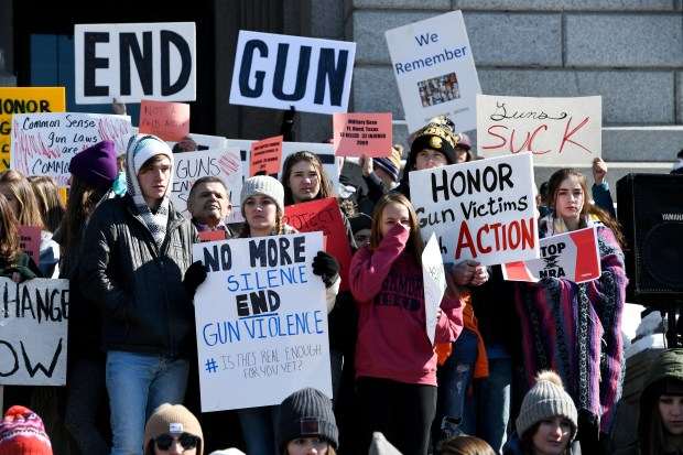 Students, teachers and community members take part in a gun violence protest on Feb. 21 at the Colorado Capitol. As many as 1,965 schools and organizations across the country are scheduled to participate in Wednesday's #Enough National School Walkout to End Gun Violence.