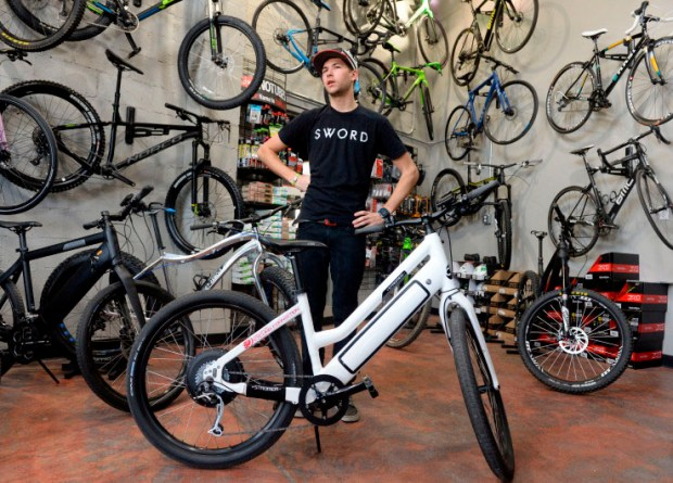 Jake Peterson of C3 Bike Shop in Golden displays an electric-assist bicycle on March 16, 2017. Colorado jurisdictions have been grappling with whether to allow e-bikes on trails that previously allowed only non-motorized bikes.