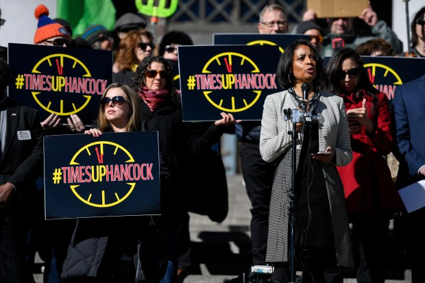 Lisa Calderon speaks during a rally calling for the resignation of Mayor Michael Hancock on Wednesday in front of the Denver City and County Building. Hancock recently acknowledged sending sexually suggestive text messages to a member of his security detail in 2012.
