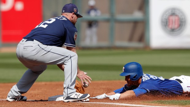 Texas Rangers' Darwin Barney, right, slides ...