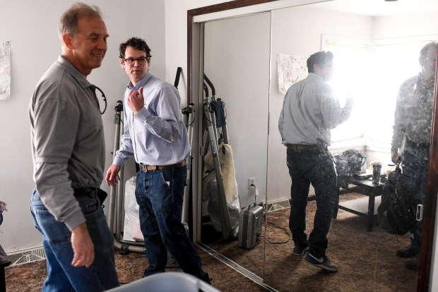 Luke Ilderton (right), energy efficiency programs director for Energy Outreach Colorado, and Ralph Yatsko, program manager, check windows in the home of Deborah Florez on April 17, 2018. Before the I-70 project heads to construction this summer, the city and CDOT are spending a few million dollars to fix up more than 250 homes that are within a block north and south of the freeway viaduct in Elyria-Swansea. The fixes include new air conditioning units, storm windows and doors and assessments for other fixes to ensure that noise and dust are kept out of the houses once four years of construction begins.
