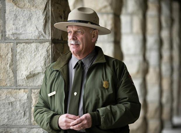 Yellowstone National Park Superintendent Dan Wenk, shown outside his office in Mammoth, Wyo., in 2013, could be reassigned to Washington, D.C., under a controversial Interior Department plan.
