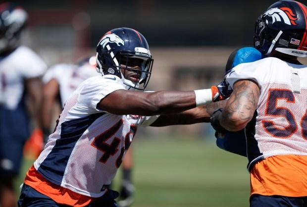 Denver Broncos linebacker Shaquil Barrett, left, ...