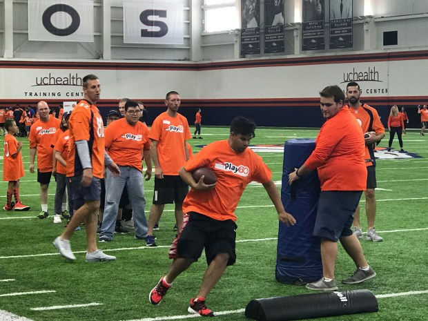 Denver Broncos players Brandon McManus (right) and Jeff Heuerman (left) work with Special Olympics Colorado athletes on Tuesday in Dove Valley as part of the NFL's Play 60 campaign. Photo by Kyle Fredrickson, The Denver Post.