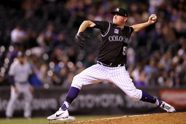 Pitcher Jake McGee #52 of the Colorado Rockies throws in the seventh inning against the San Diego Padres at Coors Field on April 23, 2018 in Denver, Colorado.