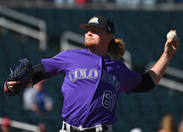 Colorado Rockies pitcher Sam Howard deliver ...