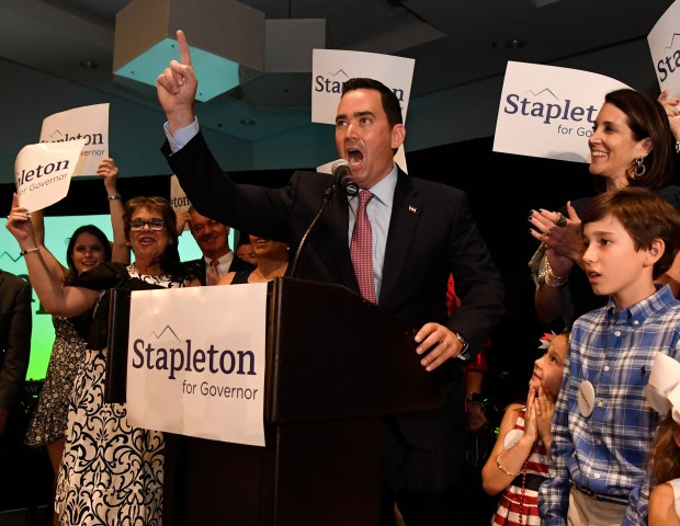 GREENWOOD VILLAGE, CO - JUNE 26: Colorado Republican gubernatorial candidate Walker Stapleton, flanked by family and supporters, fires up the crowd during his Colorado primary victory speech at the DoubleTree by Hilton Hotel in the Denver Tech Center June 26, 2018. (Photo by Andy Cross/The Denver Post)