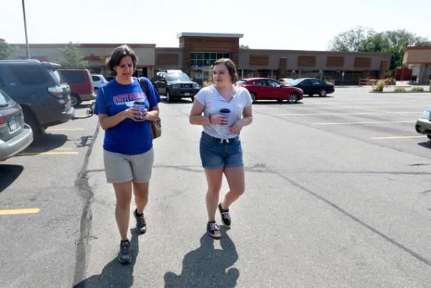 Gayle Graber, left, and her daughter, Bailey, pick up coffee at the Basemar Shopping Center in Boulder on Friday. Rumors that the complex could be converted into offices or student apartments prompted a swift decision by Boulder City Council to block retail space from being converted to housing in certain areas of town