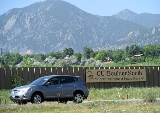 A car passes the University of Colorado South campus, where city staff, boards and concerned citizens have identified three leading strategies for flood mitigation work.
