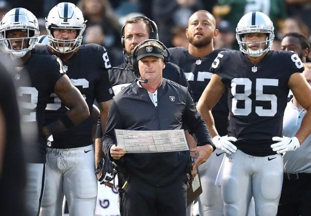 Oakland Raiders coach Jon Gruden, center, ...