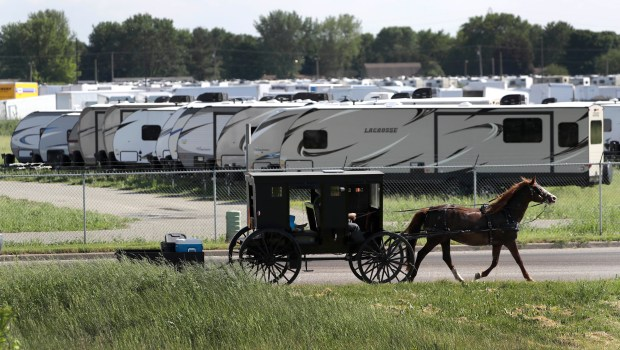 An Amish family rides their horse ...