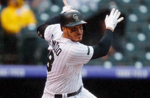 Colorado Rockies' Nolan Arenado follows the ...