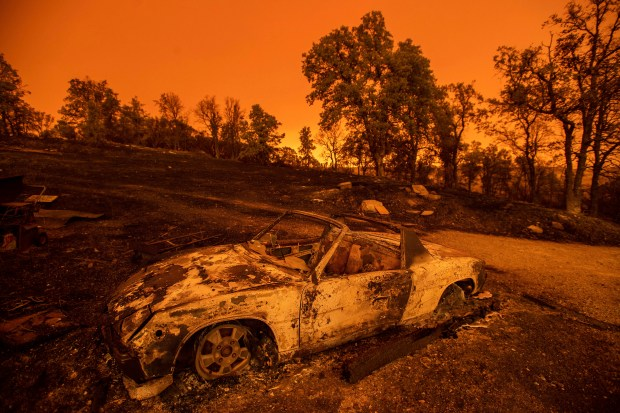Cars scorched by the Carr Fire ...