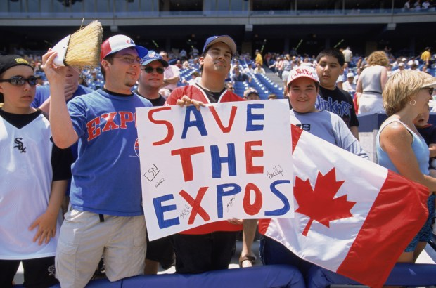 Fans of the Montreal Expos hold up signs of support during the MLB game against the Chicago White Sox at Comiskey Park in Chicago on June 9, 2002.