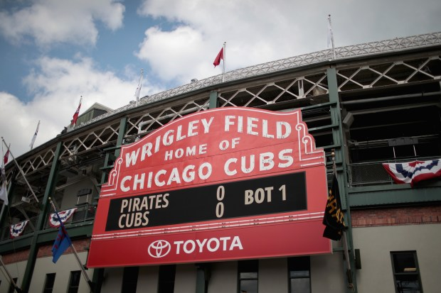 A marquee outside of Wrigley Field displays the score during the Chicago Cubs home opener on April 10, 2018 in Chicago.