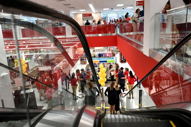 Shoppers check out the merchandise during ...
