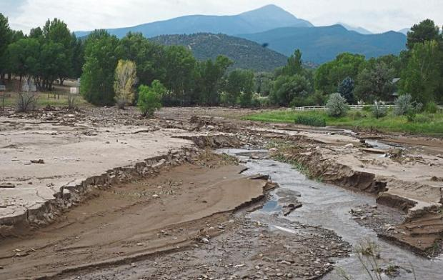 Rushing water and debris from the July 24 flood resulted in three to four feet of new silt built up in the drainage at the Harry Walker Dam off of County Road 39.