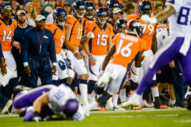Denver Broncos players watch on as ...