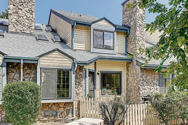 This two-bedroom townhouse in Arvada, listed earlier this summer, is believed to be the first property along the Front Range to be marketed on a major multiple listing service as accepting cryptocurrency.