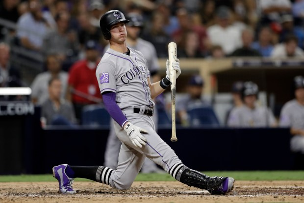 Colorado Rockies' Ryan McMahon reacts after ...