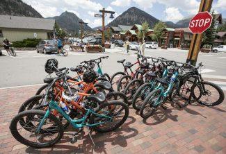 Bikes share an overcrowded bike rack Friday, Aug. 10, along Main Street in Frisco.