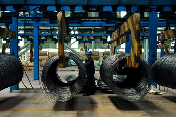 A worker transfers steel cables at a steel factory in Qingdao in east China's Shandong province. The Trump administration on Monday, July 16, brought cases against China, the European Union, Canada, Mexico and Turkey at the World Trade Organization for retaliating against American tariffs on imported steel and aluminum.