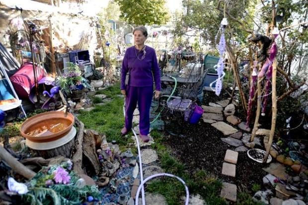 Doretta Hultquist, who has lived there for 50 years, walks through her whimsical yard at San Souci Mobile Home Park south of Boulder on Friday. Residents, including Hultquist, are concerned and confused about new rules mandated by the park's new owner.