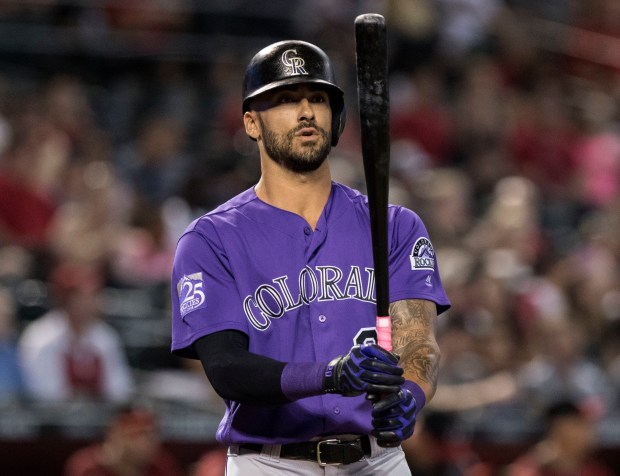 Colorado Rockies' Ian Desmond steps to ...
