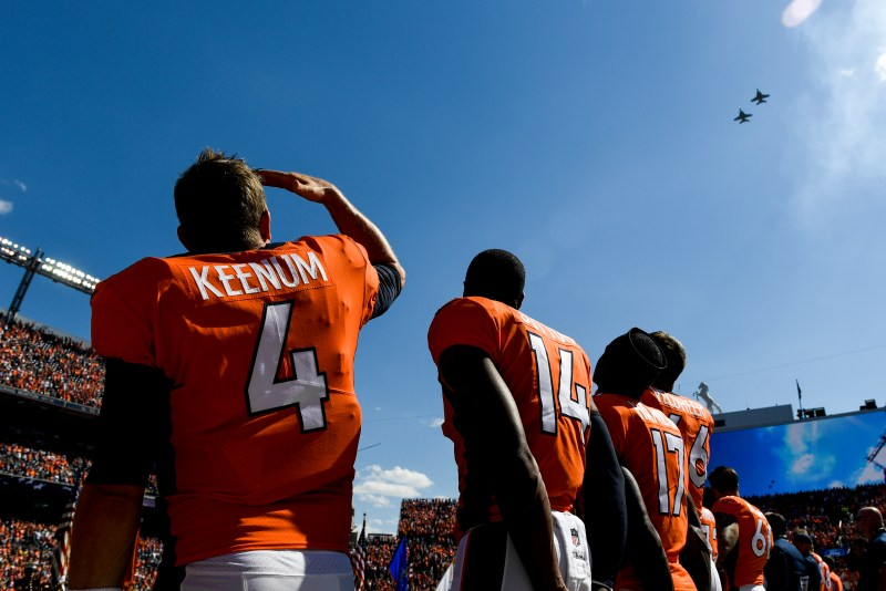 Case Keenum (4) of the Denver Broncos watches planes do a flyover before playing the Oakland Raiders in the first quarter on Sunday, September 16, 2017. The Denver Broncos hosted the Oakland Raiders.