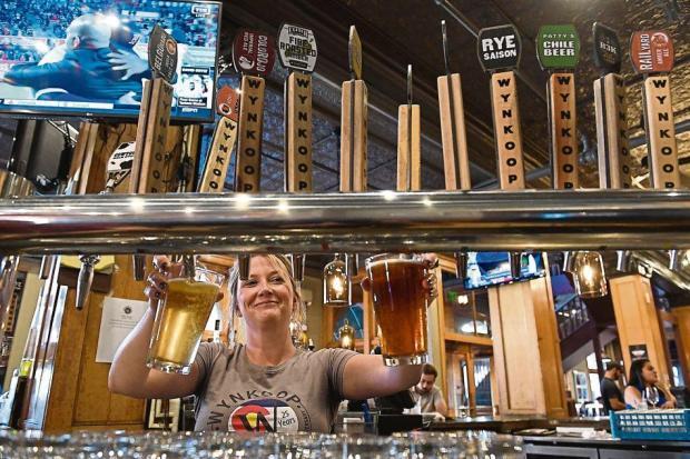 Wynkoop bartender Anne Schrader pours two ...