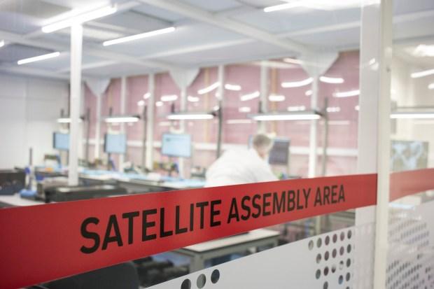 Technicians work in Spire Global's laboratory in Glasgow, Scotland.
