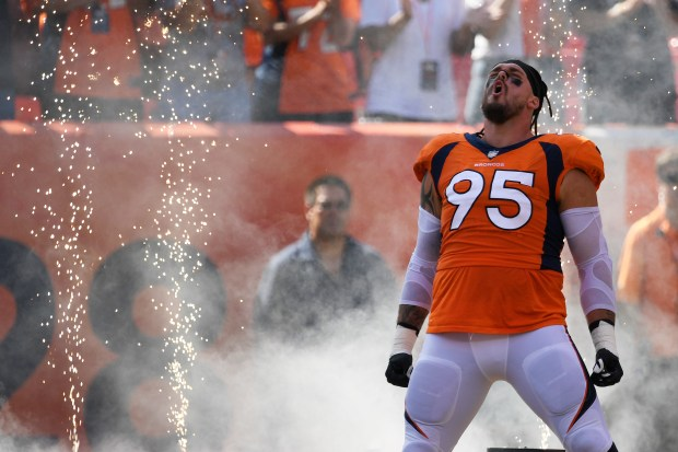 Derek Wolfe (95) of the Denver ...
