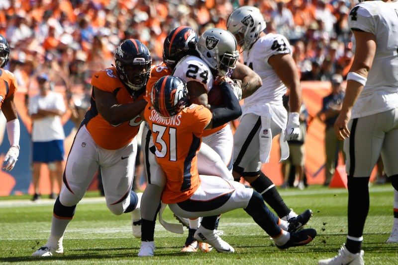 Justin Simmons (31) of the Denver ...