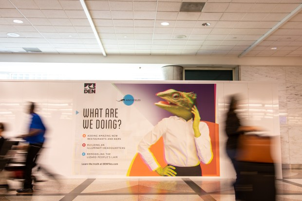 New signs at Denver International Airport embraces the conspiracy theories that surround the airport.