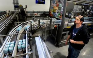 Allen Prupp monitors the canning line Friday at Oskar Blues Brewery in Longmont as the brewery canned water not beer for Hurricane Michael disaster relief. The Can'd Aid Foundation has partnered with Oskar Blues Brewery and Ball Corp. to provide more than 66,000 cans of water for Hurricane Michael relief efforts in Florida.