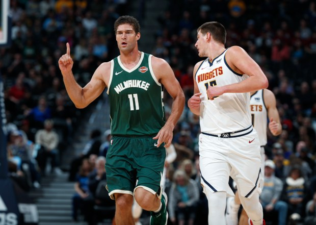 Milwaukee Bucks center Brook Lopez, left, ...