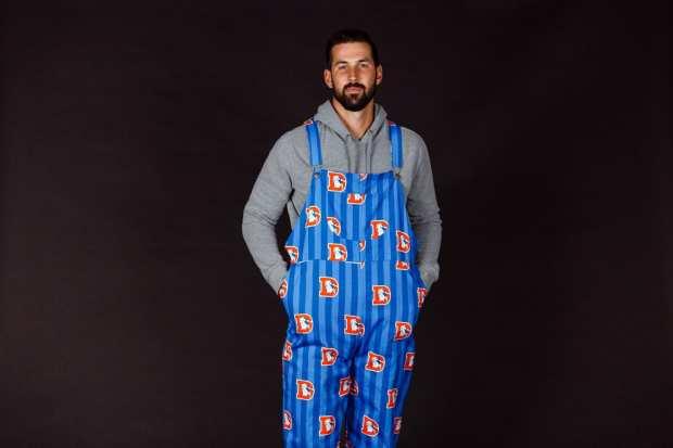Brandon McManus modeling Denver Broncos unisex NFL overalls.