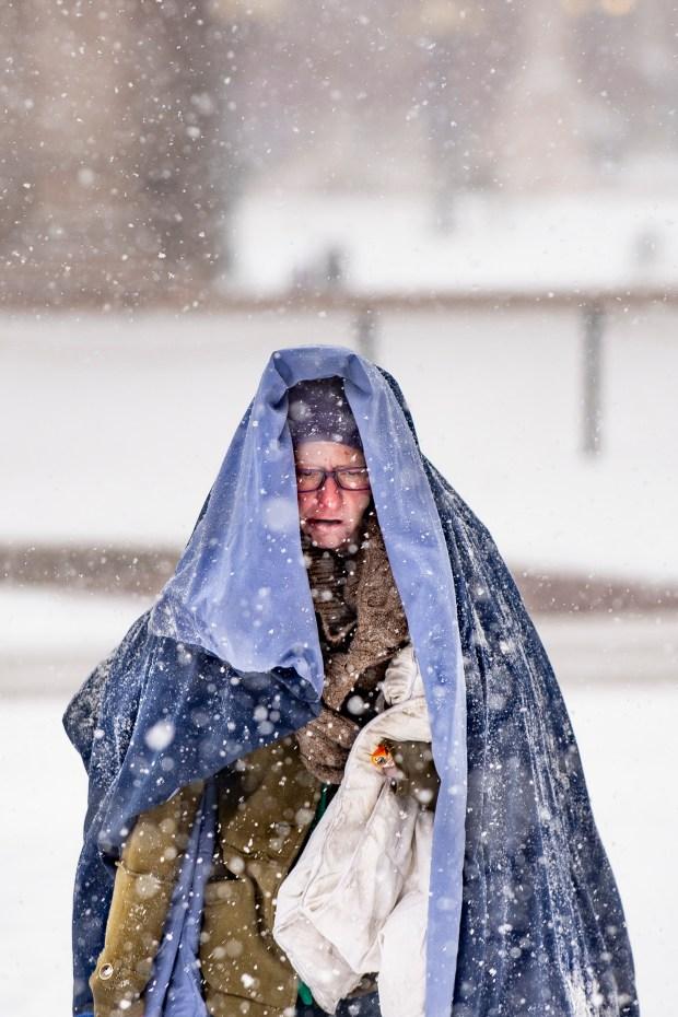 Sara Woznick wraps herself in blankets ...