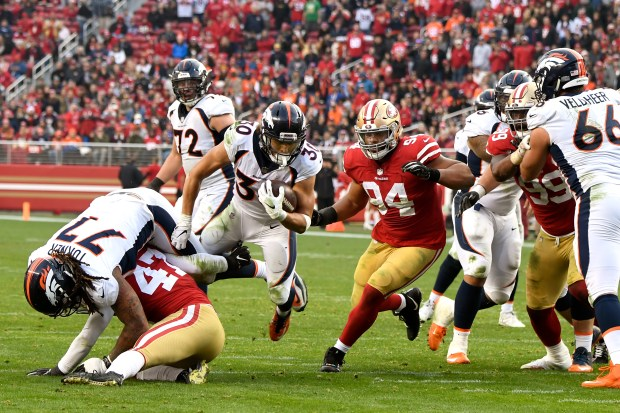 Phillip Lindsay of the Denver Broncos trying to pick up yardage as the Denver Broncos take on the San Francisco 49ers at Levi's Stadium Dec. 9, 2018 in Santa Clara, Calif.
