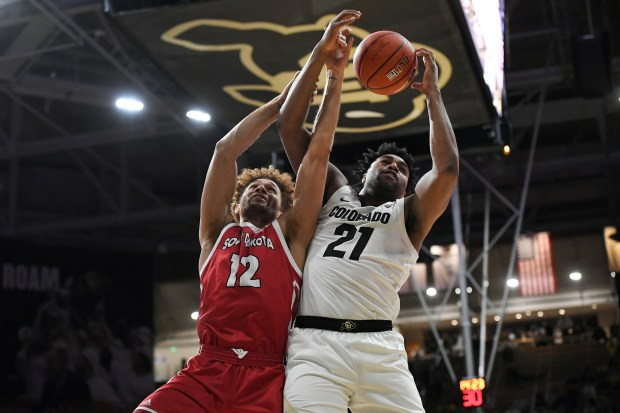 CU Buffaloes forward Evan Battey, #21, ...