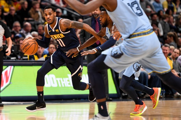 Monte Morris (11) of the Denver ...