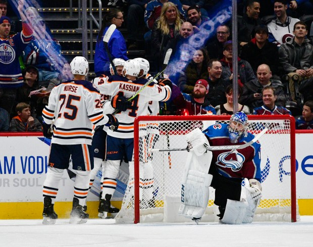 Edmonton Oilers teammates swarm Edmonton Oilers ...
