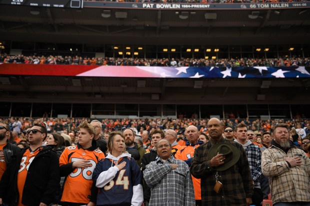 Fans stand for the National Anthem ...