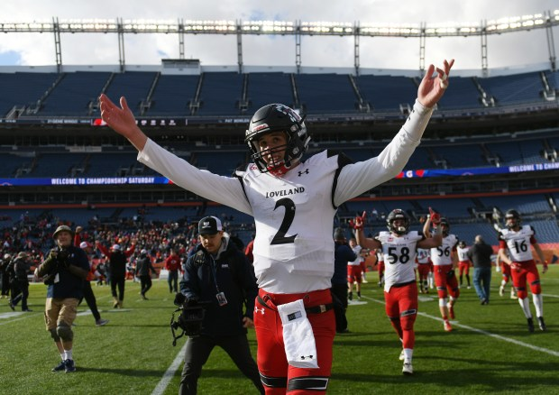 Loveland High School senior quarterback and player of the game Riley Kinney (2) celebrates defeating Skyline High School in the Class 4A football state championship Saturday, Dec. 1, 2018 at Broncos Stadium at Mile High. Loveland won the championship 62-14.